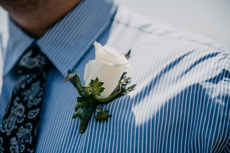 white rose elope boutonniere